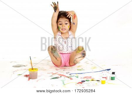 gorgeous young girl draws with paints on a white background