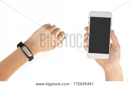 Hands with heart rate monitor watch and smartphone isolated on white