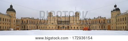 Gatchina Russia - February 23 2016: Gatchina Palace. Palace Square and the main entrance. Palace Square and the main entrance. Central building with balconies and side tower.