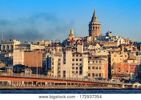 Galata tower with galata bridge and black smoke