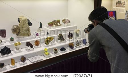 TUCSON, ARIZONA, FEBRUARY 12. The Tucson Convention Center on February 12, 2017, in Tucson, Arizona. A photographer photographs the minerals at the Tucson Gem and Mineral Show in Tucson, Arizona.