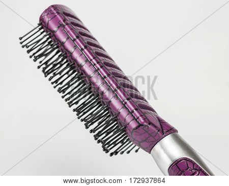 hair comb brush with handle on white background