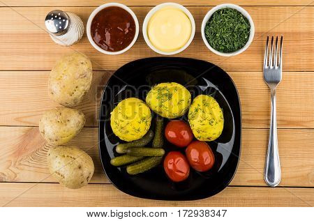 Baked Potatoes, Pickled Gherkins And Tomatoes, Greens, Bowls With Sauces