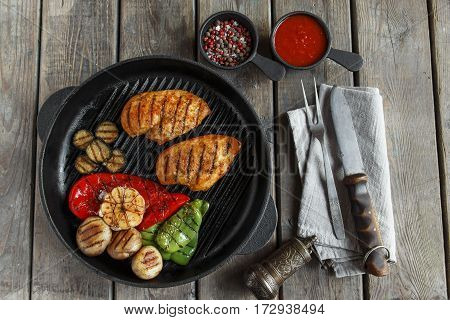 grilled chicken fillet breast  with vegetables on the grill pan