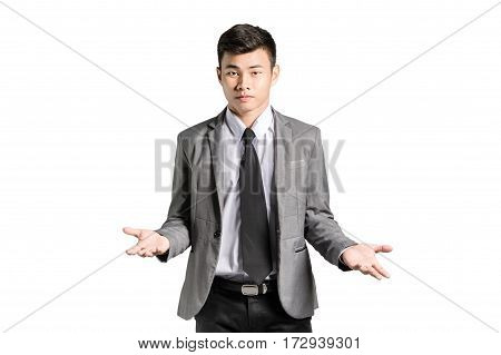Portrait of an asian business man in a pose I do not know with suit. Isolated on white background with copy space
