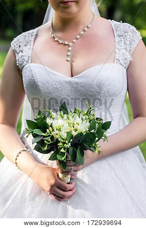 Beautiful Wedding Bouquet Of White Freesia Flowers In Bride's Hand
