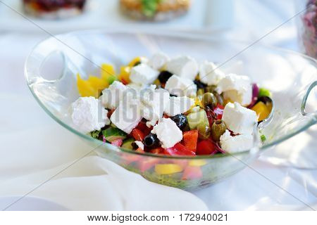 Delicious Vegetables And Goat Cheese Salad Served On A Party Or Wedding Reception