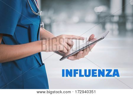 Female Doctor Using Tablet With Influenza Text.