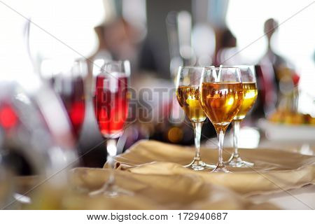 Few Glasses Of Wine, Champagne Or Another Alcoholic Beverage On A Table