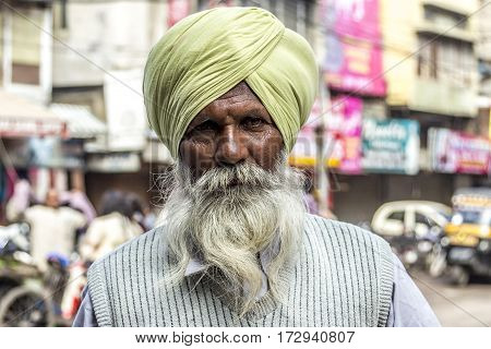 AMRITSAR INDIA - FEB 24 2013: portrait of old Sikh man with typical turban and white beard. Most people in Amritsa belong to Sikh population.