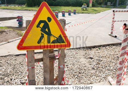 Yellow Safety Sign Warns About Roadworks. Under Construction Sign