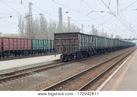Freight wagons are standing in line at the railway station. Industry