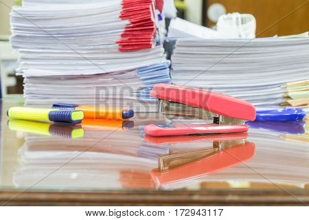 Stapler With Pens And Business Documents Stack On Table