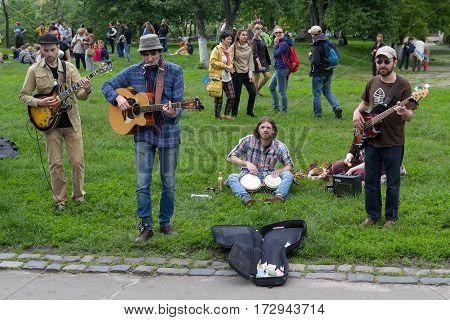 Kiev Ukraine - May 212016: Youth group playing in the park on a day off