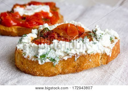 Bruschetta With Ricotta Cheese And Tomato Sauce On Fabric Background In A Form Of Heart