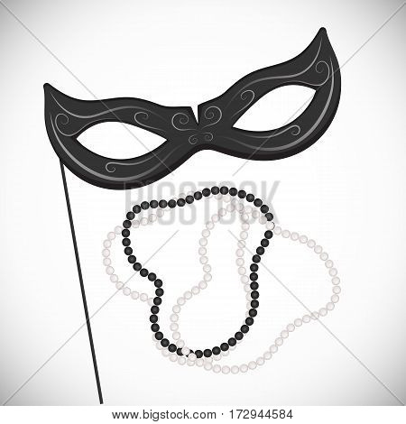 Carnival mask on a stick. Black and white pearl necklace. Mardi Gras.