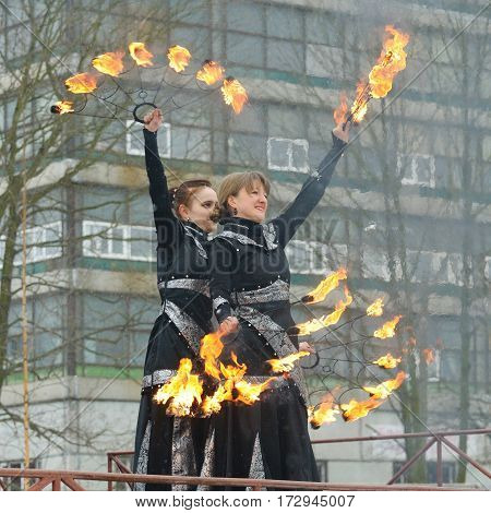 23.02.2017.Russia.Saint-Petersburg.Dancing young girls with the rotation of the chains with lights.