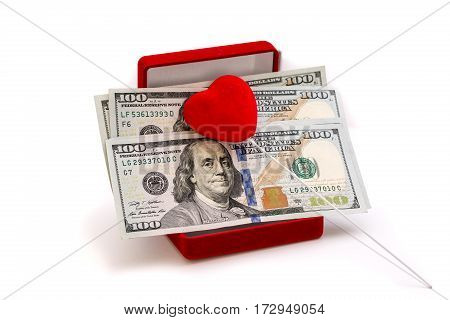 Money and red heart ni red jewelry box