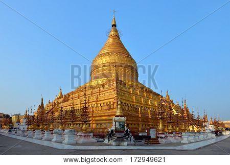 View of the golden Shwezigon Paya at sunset in Bagan, Myanmar (Burma)
