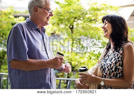 Mature couple enjoying coffee together