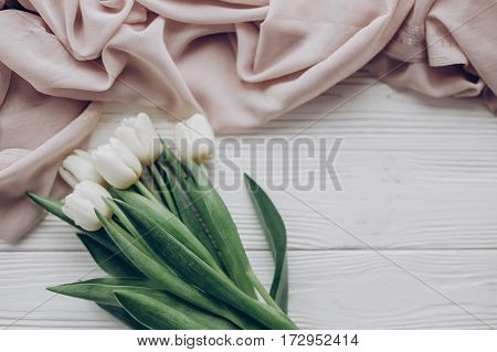 Instagram Spring Flat Lay. Stylish White Tulips And Beige Soft Fabric On Rustic Wooden Table Backgro