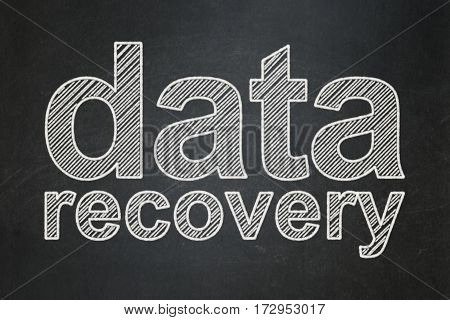 Data concept: text Data Recovery on Black chalkboard background