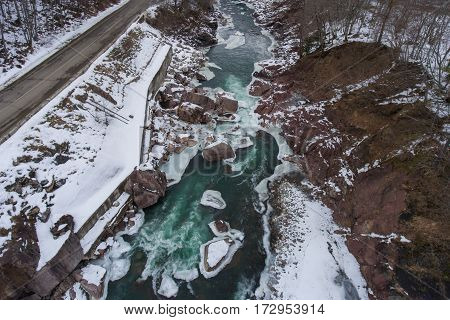 Winter Scenery. Aerial View Of The Road And Turquoise River.