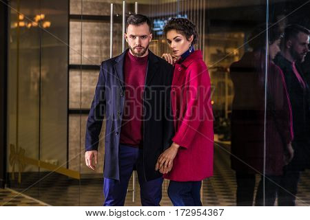 young fashionable couple posing for advertising in shopping center
