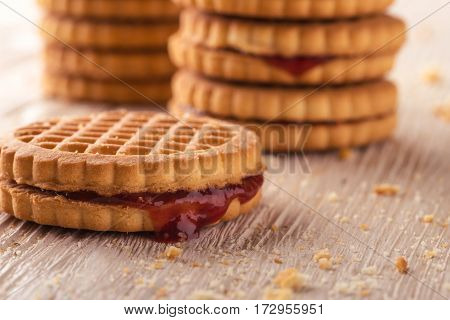 Several Biscuits With Red Homemade Marmalade On Light Board