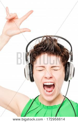 Cheerful Girl Enjoying A White Background Music On Headphones Isolated