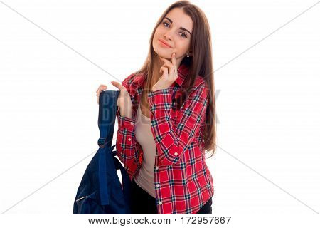 sweet stylish student girl with backpack on her shoulders posing isolated on white