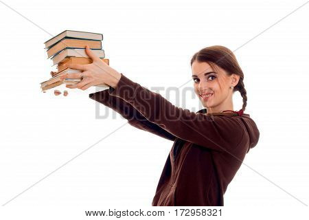 beautiful stylish student girl with pigtails in brown sports clothes and books in her hands smiling isolated on white