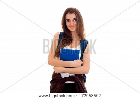 cheerful stylish student girl with backpack on her shoulders and books in her hands smiling on camera isolated on white