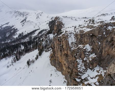 Aerial Landscape. Rocky Plateau And Snow Covered Forest..