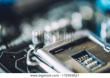 Technology and hardware electronic concept. Macro photo of Printed Circuit Board with many electrical components