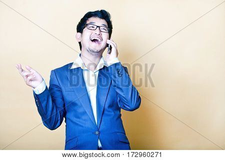 Stylish Asian man on the telephone