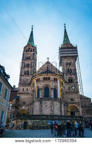 BAMBERG, GERMANY - Circa September, 2016: Low angle view of historic German Bamberg cathedral under construction with scaffolding and a clear sky overhead