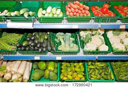 Variety of vegetables on display in supermarket