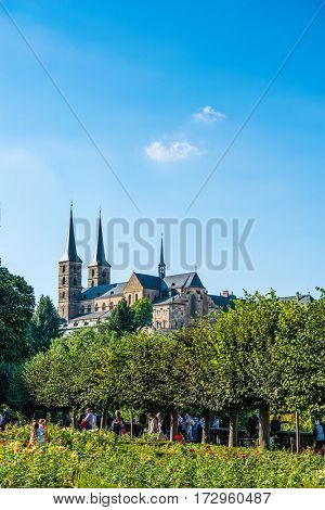 BAMBERG, GERMANY - Circa September, 2016: View across greenery of Michaelsberg Abbey, a twelfth century Romanesque Benedictine Church in Bamberg, Germany