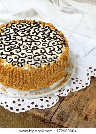 Homemade Cake With Nut Meringue Butter Cream And Decorated With Swirls Of Dark Chocolate. Kyiv Cake
