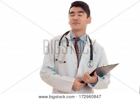 young funny brunette male doctor in uniform with stethoscope posing and laughing isolated on white