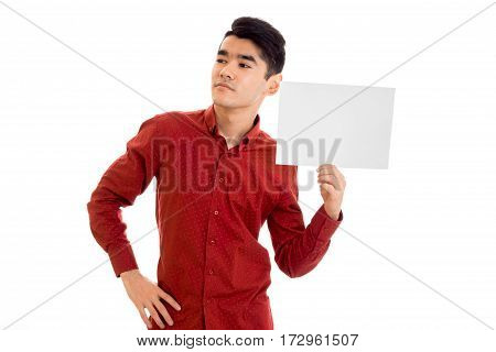 handsome young stylish male model posing in red shirt with empty placard isolated on white