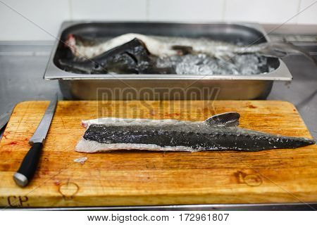 Raw Fish Sturgeon Cooking By Professional