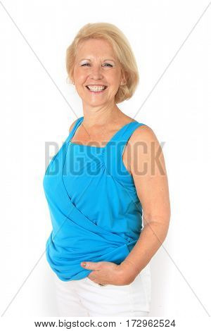 Portrait of a beautiful stylish seventy year old lady with beautiful bright smile.  Studio shot, isolated on white.