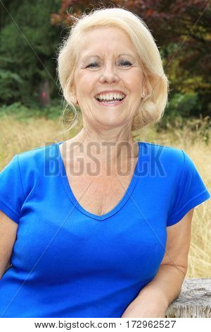 Portrait of a beautiful seventy year old lady with beautiful bright smile.  Studio shot, isolated on white.