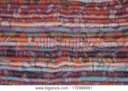 Background of Indian cashmere stoles folded stack