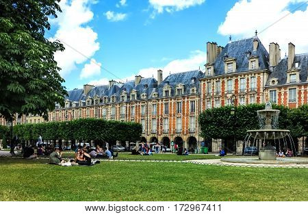 PARIS, FRANCE-JULY 29, 2016:  Paris- Place des Vosges, Square Louis XIII (built by Henri IV from 1605 to 1612) is the oldest and the most beautiful squares in Paris