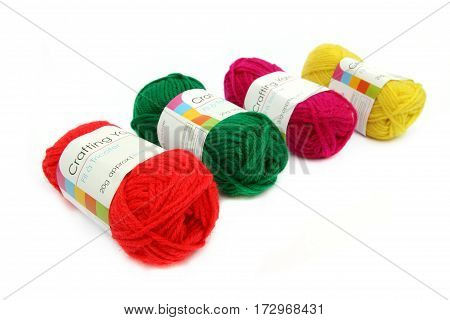Camberley, Uk - Feb 22Nd 2017: Four Balls Of Colorful Red, Green, Yellow And Pink Wool Or Yarn On A