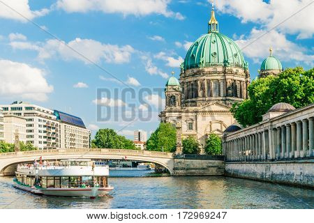 Berlin Cathedral , Berliner Dom, at famous Museum Island , Museumsinsel, with excursion boat on Spree river, Germany