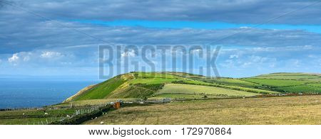North Devon coast. The hills in the Exmoor National Park. Pastures for cows and sheep on the sea shore. UK
